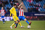 "Juan Francisco Torres Belen ""Juanfran"" of Atletico de Madrid fights for the ball with Helder Lopes of UD Las Palmas during their Copa del Rey 2016-17 Round of 16 match between Atletico de Madrid and UD Las Palmas at the Vicente Calderón Stadium on 10 January 2017 in Madrid, Spain. Photo by Diego Gonzalez Souto / Power Sport Images"