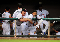Jun. 23, 2009; Albuquerque, NM, USA; Albuquerque Isotopes outfielder Manny Ramirez (right) laughs with teammate Danny Ardoin against the Nashville Sounds at Isotopes Stadium. Ramirez is playing in the minor leagues while suspended for violating major league baseballs drug policy. Mandatory Credit: Mark J. Rebilas-