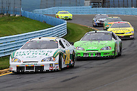 Aug. 8, 2009; Watkins Glen, NY, USA; NASCAR Nationwide Series driver Kenny Wallace (28) leads Tom Hubert during the Zippo 200 at Watkins Glen International. Mandatory Credit: Mark J. Rebilas-