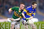 Kieran Hurley wrestles for the ball against Tipperary's Darragh Kearney last Wednesday night in Semple Stadium in the Cadbury Munster U21 Football Champonship