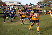 Owen Paletua leads the Te Kauwhata team out. Counties Manukau Premier Club rugby game between Te Kauwhata and Onewhero, played at Te Kauwhata on Saturday April 16th 2016. Onewhero won the game 37 - 0 after leading 13 - 0 at Halftime. Photo by Richard Spranger.