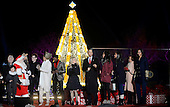 United States President Barack Obama and daughters Malia and Sasha, mother-in-law Marian Robinson and first lady Michelle Obama join performers from the stage during the national Christmas tree lighting ceremony on the Ellipse south of the White House December 3, 2015 in Washington, DC. The lighting of the tree is an annual tradition attended by the President and the first family.<br /> Credit: Olivier Douliery / Pool via CNP