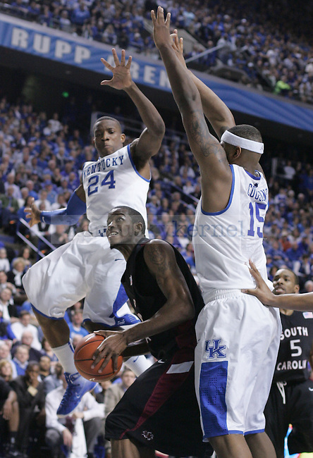 Freshman guard Eric Bledsoe and freshman forward DeMarcus Cousins defend South Carolina's Sam Muldrow during the second half of the game at Rupp Arena on Thursday. Photo by Zach Brake | Staff.