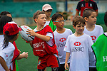 Kids attend a HSBC Staff Coaching Clinic ARFU Asian Rugby 7s at the HKFC on 23 August 2014 in Hong Kong, China. Photo by Jerome Favre /Power Sport Images