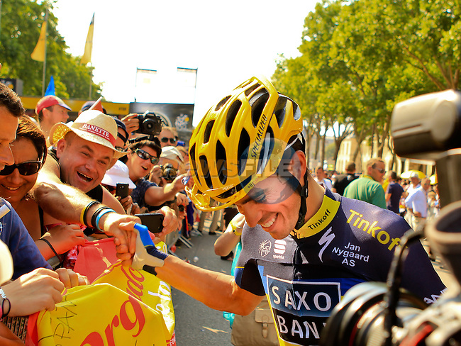 Alberto Contador (ESP) Team Saxo-Tinkoff signs autographs for fans before the start of the Final Stage 21 of the 100th Edition of the 2013 Tour de France from Versailes to Paris Champs-Elysees. 21st July 2013.<br /> (Photo:Thomas van Bracht / Peloton Photos/www.newsfile.ie)