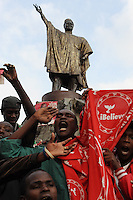 Independent Electoral and Boundaries Commission (IEBC) declared Uhuru Kenyatta as the winner of the presidential contest on 9 March 3013, after the failure of the electronic results transmission system delayed the process. Here, a group of Kenyatta's supporters celebrate his victory and sing the Kenyan National Anthem in front of the statue of assassinated statesman Tom Mboya in downtown Nairobi.