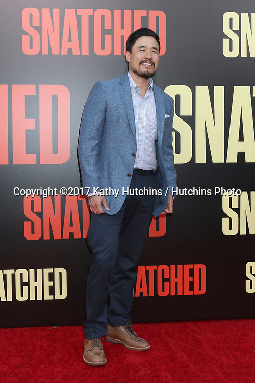 "LOS ANGELES - MAY 10:  Randall Park at the ""Snatched"" World Premiere at the Village Theater on May 10, 2017 in Westwood, CA"