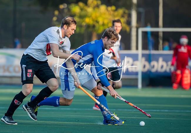 UTRECHT -  Jip Janssen (Kampong) met Mirco Pruyser (Adam)   tijdens de hoofdklasse hockeywedstrijd mannen, Kampong-Amsterdam (4-3).  COPYRIGHT KOEN SUYK