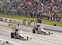 Sep 25, 2016; Madison, IL, USA; NHRA top fuel driver Tony Schumacher (left) defeats Leah Pritchett during the Midwest Nationals at Gateway Motorsports Park. Mandatory Credit: Mark J. Rebilas-USA TODAY Sports