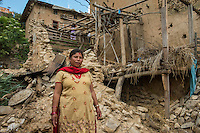 Nepal, Kavre District, Nala, earthquake relief efforts. TEWA project supported by Global Fund for Women. Sabita Shrestha (in yellow), an executive director with TEWA, her husband encouraged her to join. Their home was badly damaged and they lost some animals. They'll know be getting some financial support through TEWA.