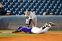 Trenton Thunder third baseman Rob Segedin #26 tags out Quincy Latimore #22 sliding into third during a game against the Akron Aeros on April 22, 2013 at Canal Park in Akron, Ohio.  Trenton defeated Akron 13-8.  (Mike Janes/Four Seam Images)