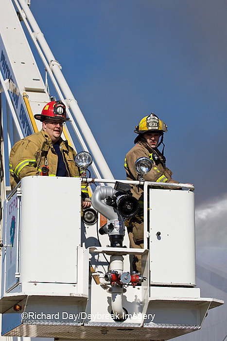 63818-022.12 Firefighters extinguishing warehouse fire using aerial ladder truck, Salem, IL