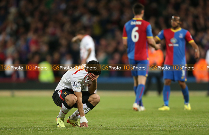 A distraught Luis Suarez of Liverpool at the end of the game - Crystal Palace vs Liverpool, Barclays Premier League at Selhurst Park, Crystal Palace, London - 05/05/14 - MANDATORY CREDIT: Rob Newell/TGSPHOTO - Self billing applies where appropriate - 0845 094 6026 - contact@tgsphoto.co.uk - NO UNPAID USE