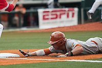 Texas Longhorns second baseman Brooks Marlow (8) dives back to first base during the NCAA baseball game against the Houston Cougars on June 6, 2014 at UFCU Disch–Falk Field in Austin, Texas. The Longhorns defeated the Cougars 4-2 in Game 1 of the NCAA Super Regional. (Andrew Woolley/Four Seam Images)