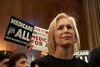 "United States Senator Kirsten Gillibrand (Democrat of New York) joins US Senator Bernie Sanders (Independent of Vermont) as he announces he has introduced a new version of his ""Medicare for All"" plan at a press conference on Capitol Hill in Washington DC on April 10, 2019.  The Sanders plan will replace job-based and private health insurance with a government plan that guarantees coverage, including long-term care, for all citizens. Photo Credit: Stefani Reynolds/CNP/AdMedia"