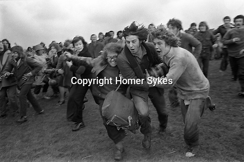 Bottle Kicking and Hare Pie Scrambling. Hallalton Leicestershire. England 1973. Easter Monday annually.<br /> Anthony Norman centre with bottle, he made a long run down the hill, and is about to score a goal for Hallalton.