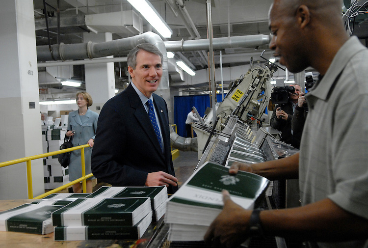 Office of Management and Budget (OMB) Director Rob Portman, talks with Government Printing Office (GPO) employee Jeffrey Hayden while copies of The Budget of the United States Government, Fiscal Year 2008, roll of the presses.