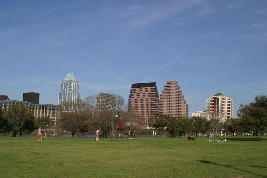 It's clear skies as Austinites enjoy flying kites on Zilker Park and Auditorium Shores by the Zilker Loop Trail.