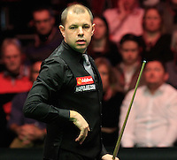 Barry Hawkins eyes up his next shot during the Dafabet Masters FINAL between Barry Hawkins and Ronnie O'Sullivan at Alexandra Palace, London, England on 17 January 2016. Photo by Liam Smith / PRiME Media Images