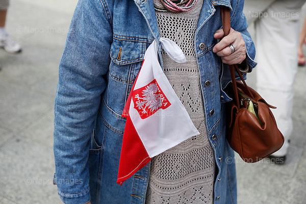 LODZ, POLAND, JUNE 26, 2010:.Kaczynski supporter with Polish flag. Jaroslaw Kaczynski campaigning for president in Lodz..(Photo by Piotr Malecki / Napo Images / Forum) ..LODZ, 20/06/2010.Zwolenniczka Jaroslawa Kaczynskiego z polska flaga. Wiec wyborczy w Lodzi..Fot: Piotr Malecki / Napo Images / Forum.