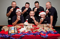 Celebrating with goodies from Greggs are firefighters from Stockhill Fire Station, Nottingham. Pictured back row, from left: Steve Dunnett, Martin Aldred, Ben Smith, Robin Watts. Front row Richard Lord, Tim Roe and Nick Cousins.