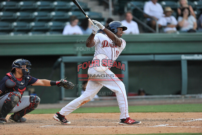 First baseman Josh Ockimey (18) of the Greenville Drive bats in a game against the Rome Braves on Sunday, July 31, 2016, at Fluor Field at the West End in Greenville, South Carolina. The Rome catcher is Jonathan Morales. Rome won, 6-3. (Tom Priddy/Four Seam Images)