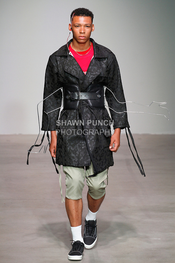 Model walks runway in an outfit from the Sanchez-Kane Spring Summer 2018 collection by Barbara Sanchez-Kane, at Skylight Clarkson Square on July 12, 2017; during New York Fashion Week: Men's Spring Summer 2018.