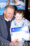 Dan Foley with little Nial one of the winners in the Listowel art competition in the Listowel Arms Hotel on Friday night.