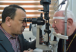 Bishop William Murphy of Rockville Centre (right), gets his vision checked by Dr. Ahmed Fonad Al Elulaimy, an ophthalmologic surgeon, in the Mar Narsai Clinic in Dahuk, Iraq, on April 10, 2016. The clinic was built and equipped by the Catholic Near East Welfare Association--of which Bishop Murphy is a member of the board--to meet the needs of Christians and others displaced to Dahuk because of attacks by ISIS.<br /> <br /> Bishop Murphy came to northern Iraq with Cardinal Timothy Dolan, the archbishop of New York and chair of CNEWA, and other church leaders to visit with Christians and others affected by ISIS. <br /> <br /> CNEWA is a papal agency providing humanitarian and pastoral support to the church and people in the region.