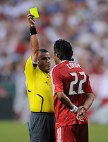 Center Referee Baldomero Toledo gives Chicago Fire defender William Conde (22)  a yellow card after a foul.  DC United defeated the Chicago Fire 2-1 at  RFK Stadium, Saturday June 13, 2009.