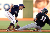 Jeff Bianchi (6) of the Northwest Arkansas Naturals tags out Blake Tekotte (11) of the San Antonio Missions while stealing during a game against the San Antonio Missions at Arvest Ballpark on June 30, 2011 in Springdale, Arkansas. (David Welker / Four Seam Images)