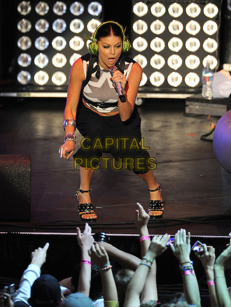THE BLACK EYED PEAS - FERGIE (Stacy Ann Ferguson).Live at The 102.7's KIIS-FM's Wango Tango 2009 held at The Verizon Wireless Ampitheatre in Irvine, California, USA..May 9th, 2009 .full length stacey stage concert live gig show performance music black cropped trousers top singing bending crouching  harem pants drop crotch belly stomach midriff print green headphones earmuffs.CAP/DVS.©Debbie VanStory/Capital Pictures.
