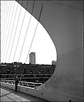 The Puente de la Mujer is a footbridge in the Puerto Madero district of Buenos Aires. The cantilever spar cable-stayed bridge was designed by Santiago Calatrava. The bridge was a gift from Don Alberto L. Gonzalez. Work started in 1998 and the bridge was completed in 2001.