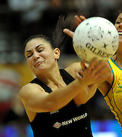 NZ's Temepara George takes a pass under pressure from natalie Von Bertouch. International Netball  - New Zealand Silver Ferns v Australian Diamonds Constellation Cup match at TSB Bank Arena, Wellington on Thursday, 2 September 2010. Photo: Dave Lintott/lintottphoto.co.nz.
