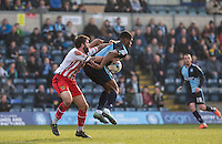 Rowan Liburd of Wycombe Wanderers beats Dean Wells of Stevenage to the ball during the Sky Bet League 2 match between Wycombe Wanderers and Stevenage at Adams Park, High Wycombe, England on 12 March 2016. Photo by Andy Rowland/PRiME Media Images.