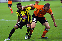 Avram papadopoulos holds off Roy Krishna (left) during the A-League football match between Wellington Phoenix and Brisbane Roar at Westpac Stadium in Wellington, New Zealand on Saturday, 22 December 2018. Photo: Dave Lintott / lintottphoto.co.nz