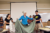 Heloise, center, demonstrates a trick to folding a fitted sheet to to Katherine Ramos, left, and Vasjan Broka, right. Heloise talks to students at the Honors Summer Math Camp at Texas State University in San Marcos, Texas about living away from home.  July 14, 2009.