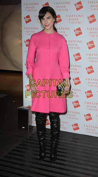 Caroline Sieber.Valentino: Master of Couture Exhibition Private View at Somerset House, Embankment Gardens, London, England..28th November 2012  .full length dress black boots clutch bag pink buttons .CAP/WIZ.© Wizard/Capital Pictures.