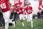 Wisconsin Badgers teammates run onto the field prior to an NCAA College Big Ten Conference football game against the Michigan Wolverines Saturday, November 18, 2017, in Madison, Wis. The Badgers won 24-10. (Photo by David Stluka)