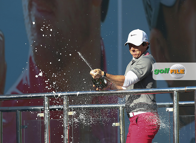 Rory McIlroy (NIR) celebrates his win of the Final Round of the BMW PGA Championship with champagne from the bridge, at Wentworth Golf Club, Virginia Waters, London, UK. Picture:  David Lloyd / www.golffile.ie