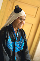Their tiny black lambskin cap called tailebaike easily identifies Uyghur women of the oasis town of Yutian. Many have described it as looking like an inverted teapot on the head. This kind of cap, which used to be given to the host on the occasion of a wedding or funeral, has now become the accepted headgear for married Yutian women.