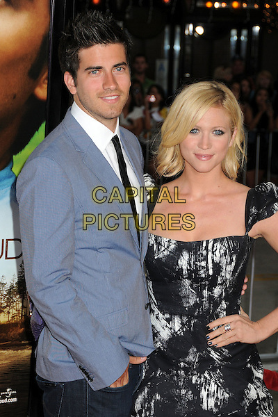 """RYAN ROTTMAN & BRITTANY SNOW .""""Charlie St. Cloud"""" Los Angeles Premiere held at the Regency Village Theatre, Westwood, California, USA, 20th July 2010. .half length couple blue suit jacket black tie white shirt print dress hand on hip .CAP/ADM/BP.©Byron Purvis/AdMedia/Capital Pictures."""