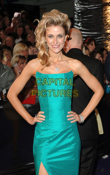 KATHERINE KELLY.Arrivals at the British Soap Awards 2007, BBC Television Centre, London, England. .May 26, 2007.half length green turquoise strapless dress hands on hips  catherine .CAP/BEL.©Belcher/Capital Pictures