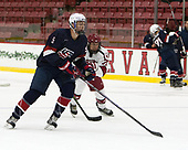 Nate Knoepke (NTDP - 5), Frédéric Grégoire (Harvard - 71) - The Harvard University Crimson defeated the US National Team Development Program's Under-18 team 5-2 on Saturday, October 8, 2016, at the Bright-Landry Hockey Center in Boston, Massachusetts.