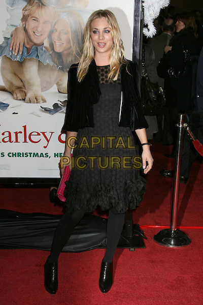 "KALEY CUOCO.""Marley & Me"" Los Angeles Premiere held at the Mann Village Theater, Westwood, California, USA..December 11th, 2008.full length black dress jacket ankle boots shoes red clutch bag polka dot sheer .CAP/ADM/MJ.©Michael Jade/AdMedia/Capital Pictures."