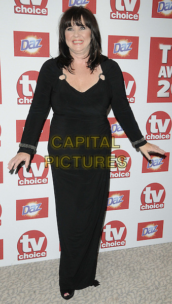 Coleen Nolan.The TV Choice Awards 2012, Dorchester Hotel, Park Lane, London, England..September 10th, 2012.full length black dress hands arms smiling funny .CAP/CAN.©Can Nguyen/Capital Pictures.