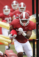 NWA Democrat-Gazette/ANDY SHUPE<br /> Arkansas running back David Williams carries the ball Tuesday, Aug. 1, 2017, through a practice device during practice at the university's practice field in Fayetteville. Visit nwadg.com/photos to see more photographs from the day's practice.