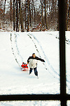 A sneak peek from the kitchen window watching Alex's first day in the snow with the family December 2009.