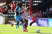 Lee Holmes of Exeter City battles for the ball with Marcus Bean of Wycombe Wanderers during the Sky Bet League 2 match between Exeter City and Wycombe Wanderers at St James' Park, Exeter, England on 26 September 2015. Photo by Pinnacle Photo Agency.