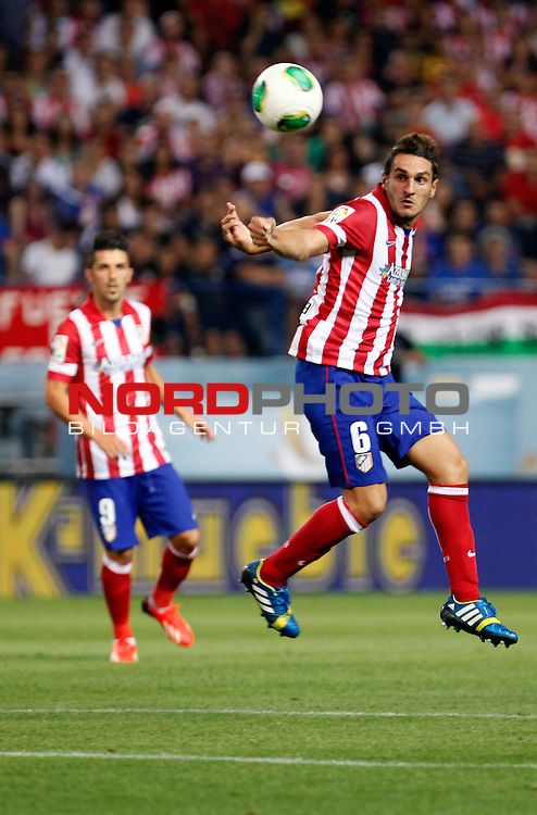 Atletico de Madrid's Koke (r) during Supercup of Spain 1st match.August 21,2013. Foto © nph / Victor Blanco)